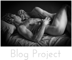 """Blog Project"" button - black and white image of two men in naked embrace in bed"