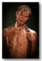 Travis Gallery button - gritty shirtless man in chains