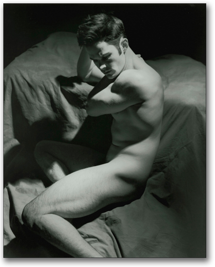 Black and white of male nude sculpted in a strong down light