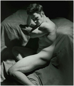 Classic black and white of a naked contorted male in sculpted down light